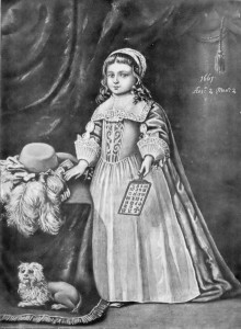 young girl holding a hornbook