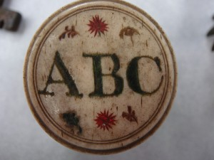 Lid from a box of counters, each inscribed with letters of the alphabet from the Mary Greg Collection